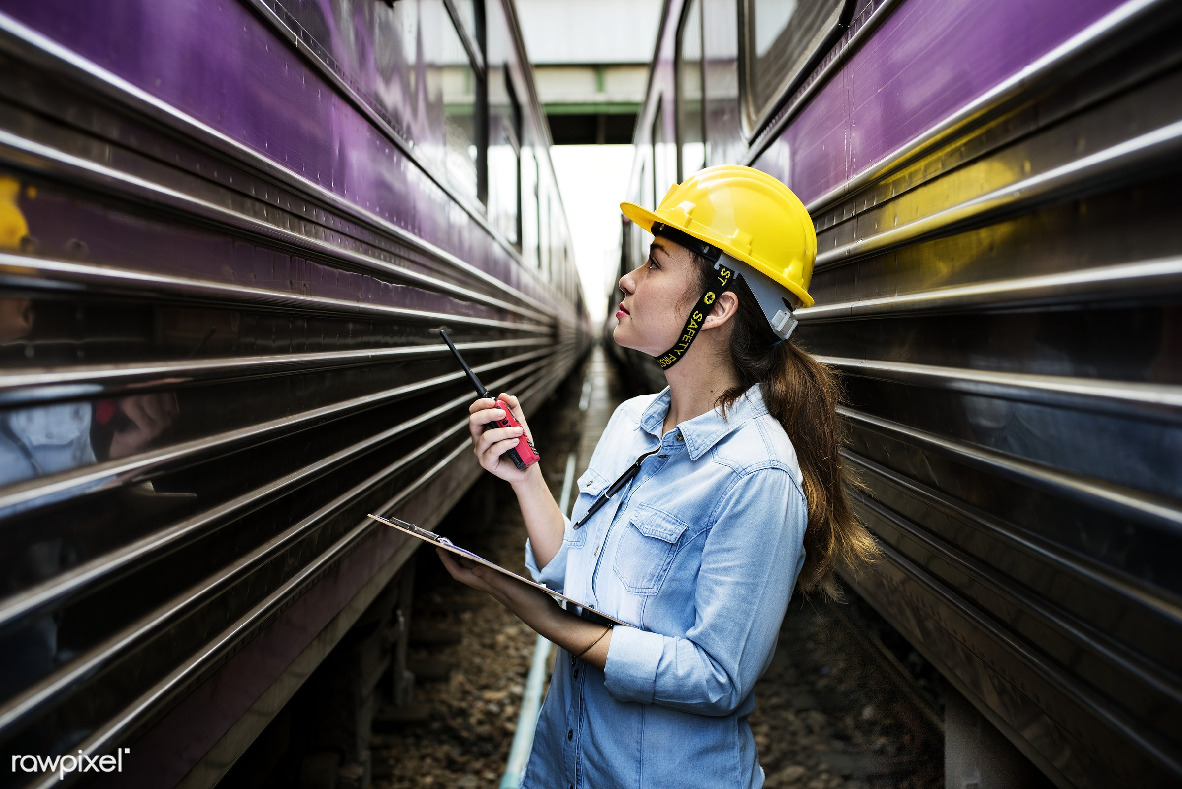 Female inspector at railroad tracks - construction, industry, developer, engineer, industrial, architect, architecture,...