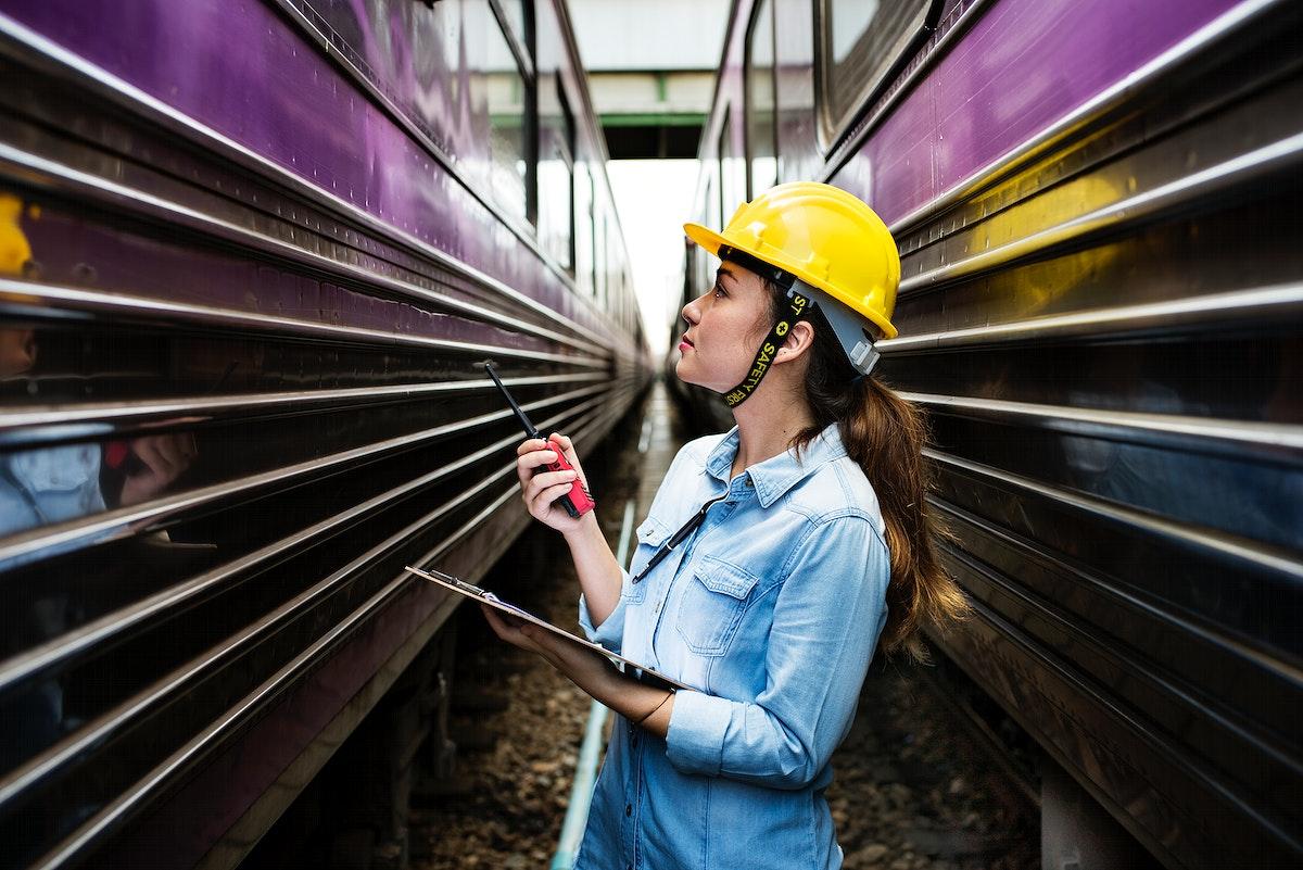 Female inspector at railroad tracks