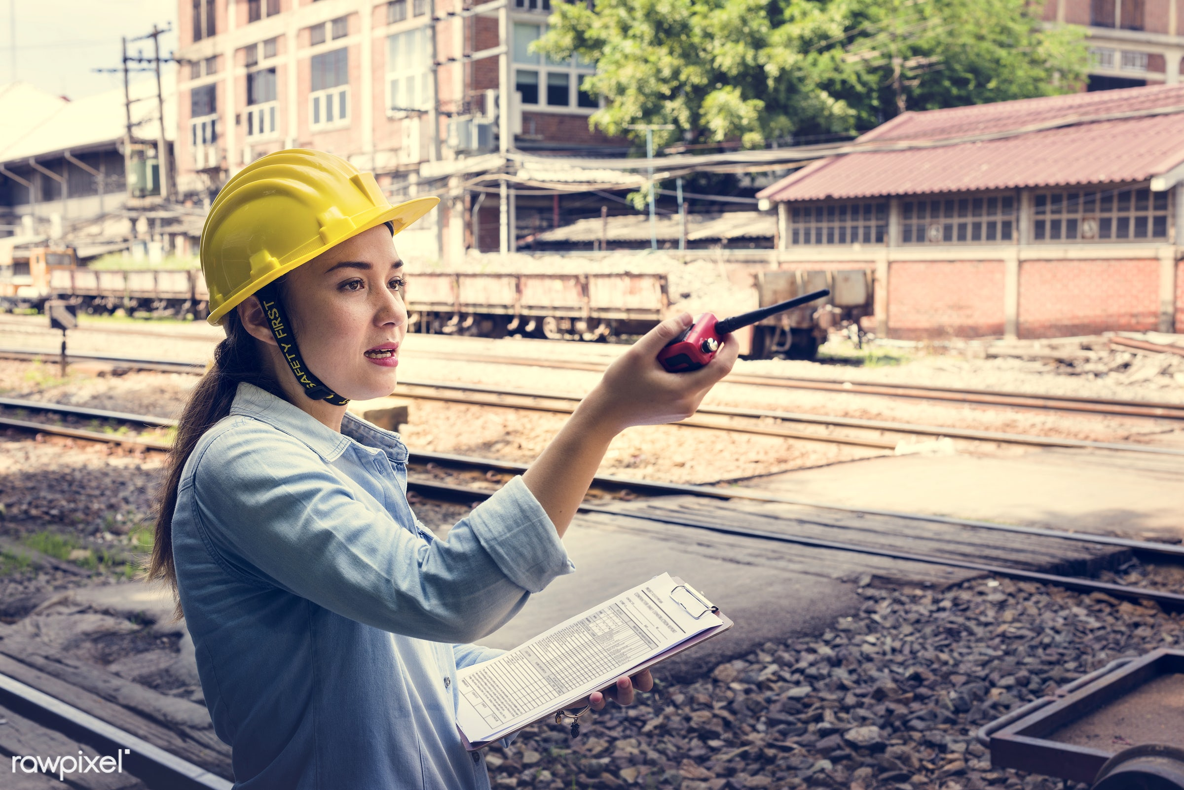 Female inspector at railroad tracks - railway, architect, architecture, asian, assistance, career, checking, clipboard,...