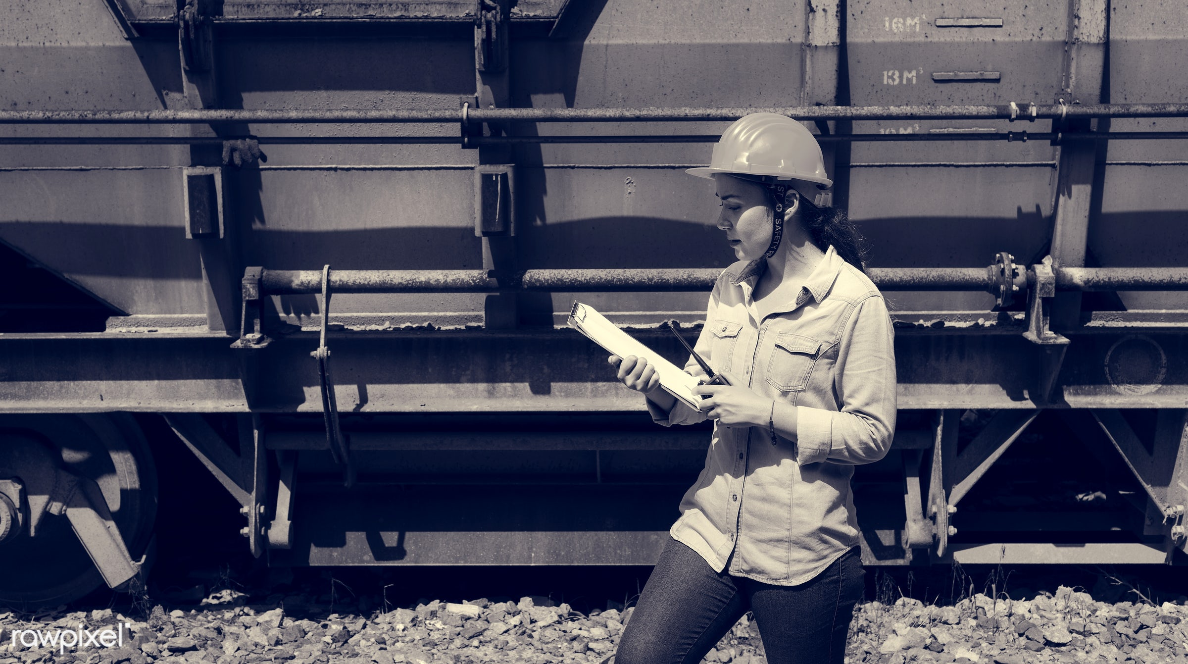 Female inspector at railroad tracks - architect, architecture, asian, assistance, career, clipboard, construction,...