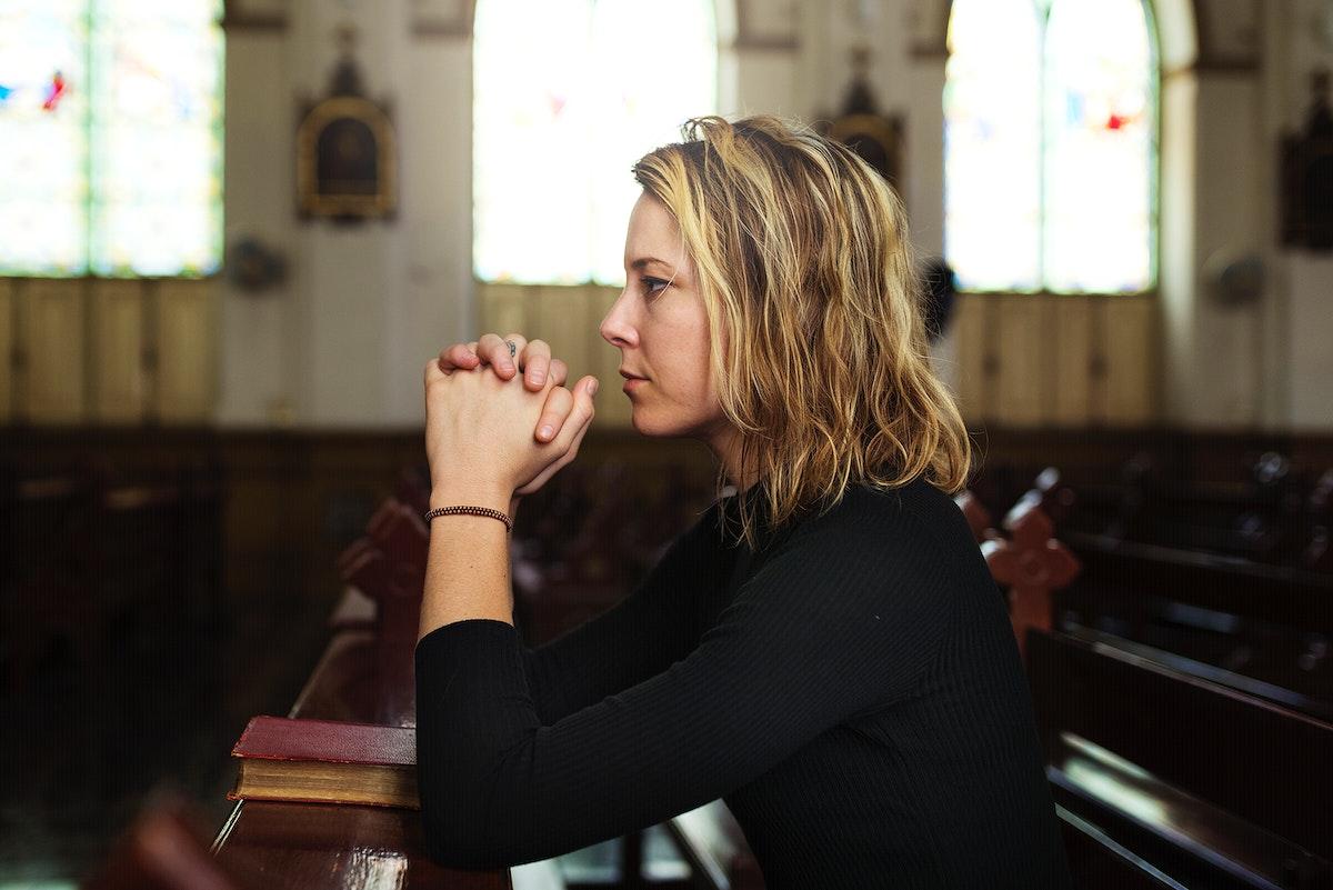 Woman praying in the church