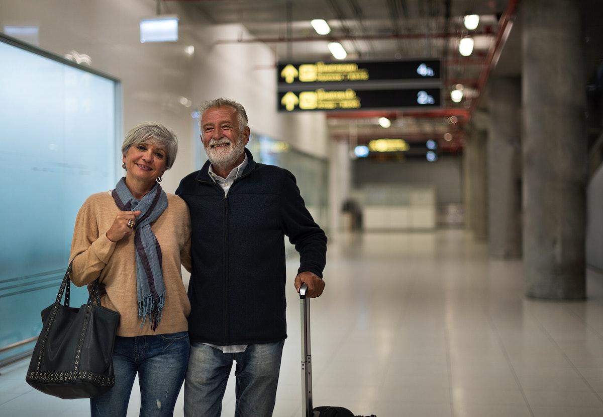 Senior couple traveling airport scene