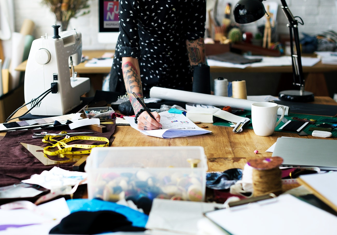 Fashion Designer Drawing And Preparing For A New Design Royalty Free Photo 12053