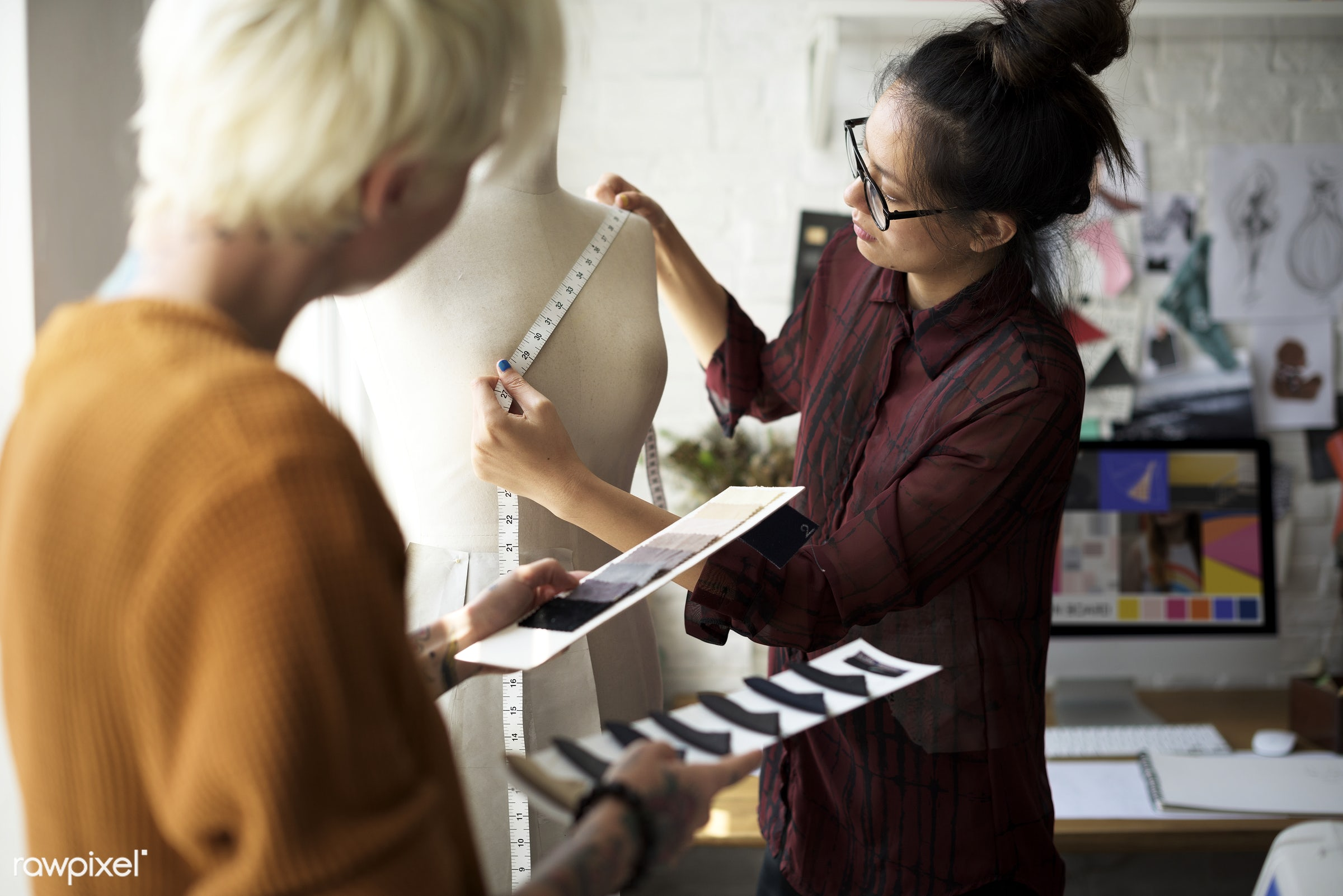 Fashion designer using a measuring tape on a manequin - model, fashion, measure, clothing materials, clothing, designing,...