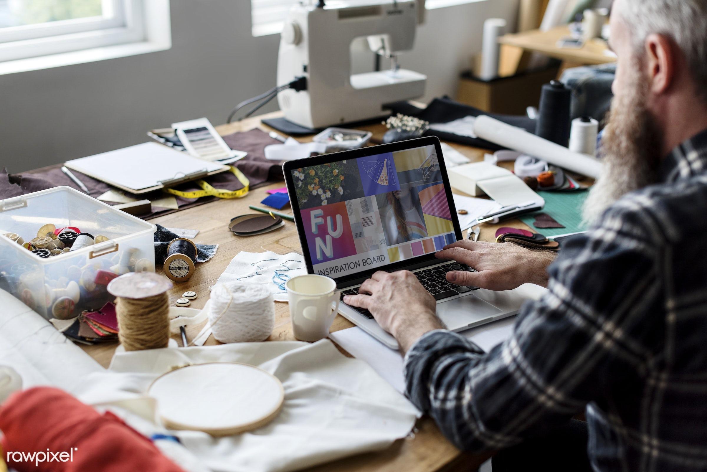 Fashion Designer working using his laptop - studio, computer, trends, reflection, idea, concept, person, fashion, technology...