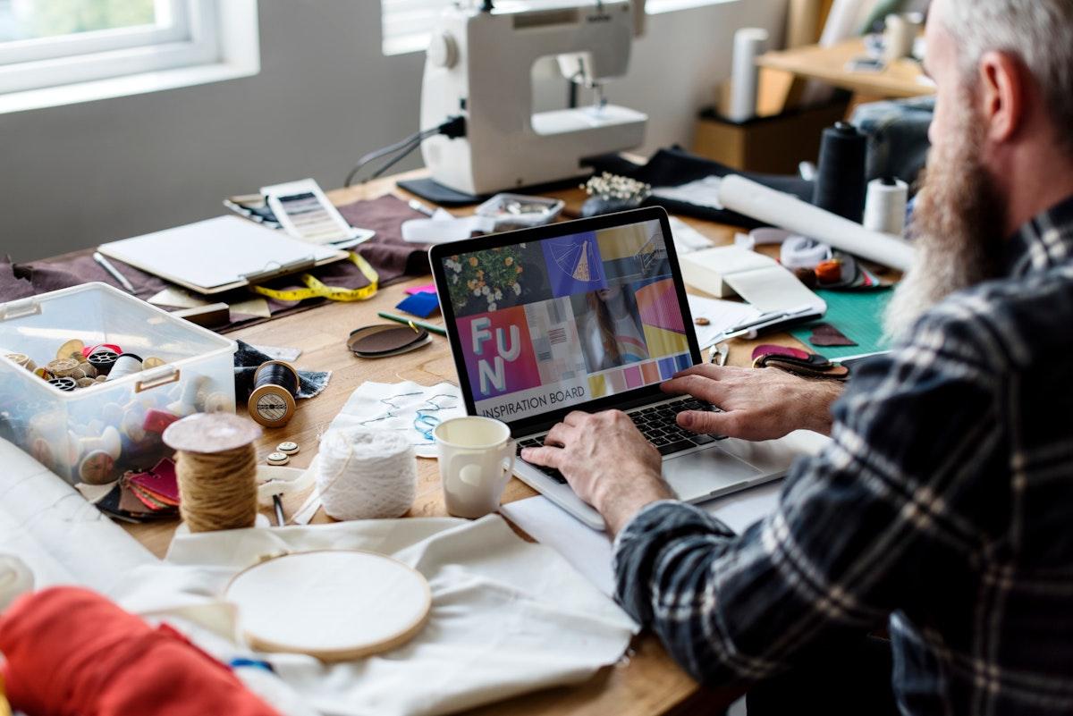 Fashion Designer working using his laptop