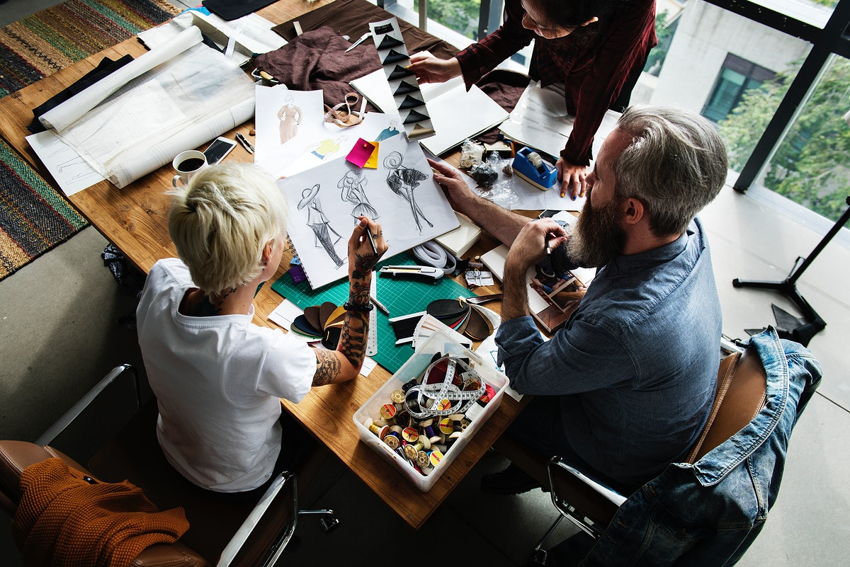 Fashion designers working together in a studio
