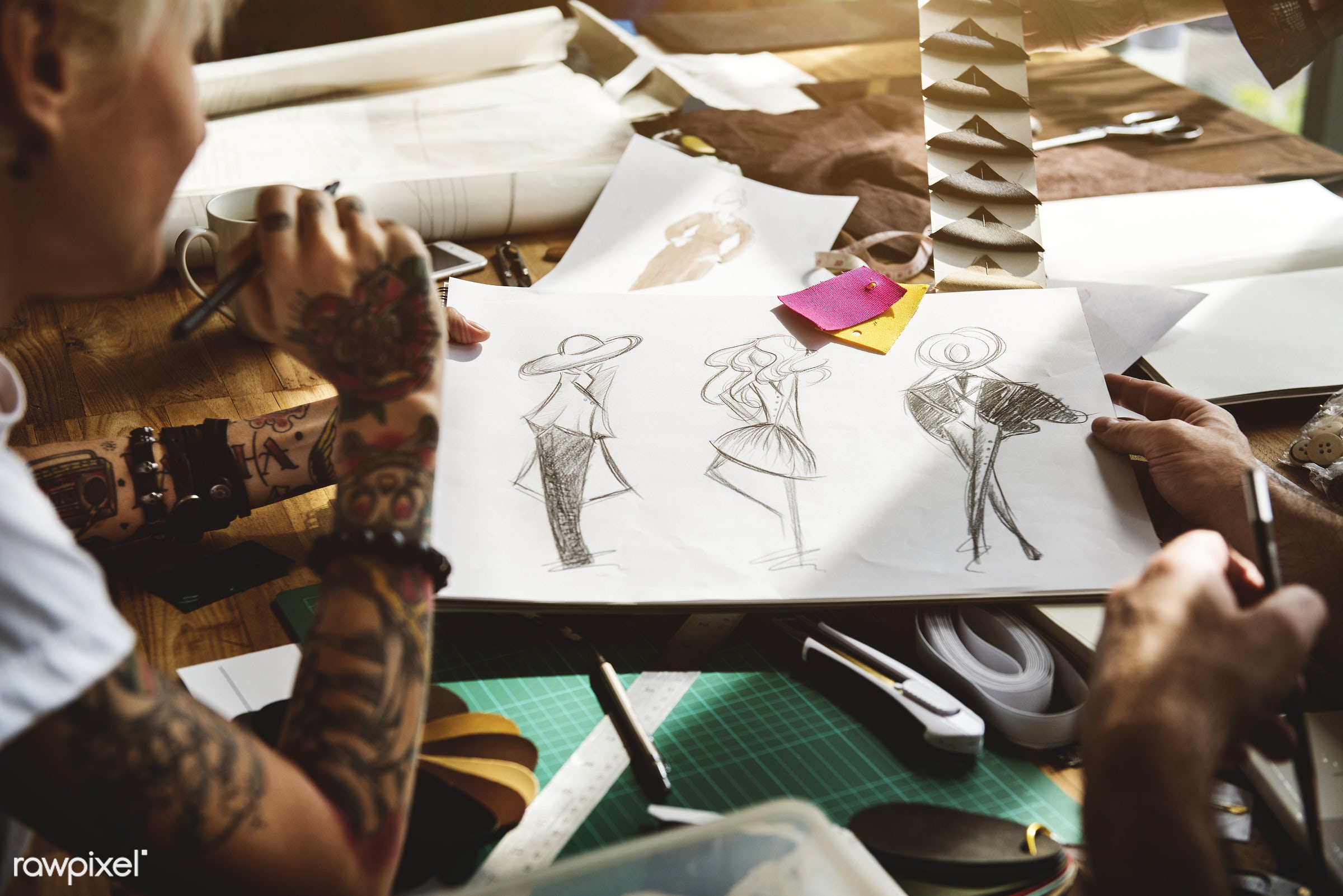 Fashion designer drawing, working in a studio - manufacturing, fashion, concept, clothing, paper, garment, talent, trendy,...