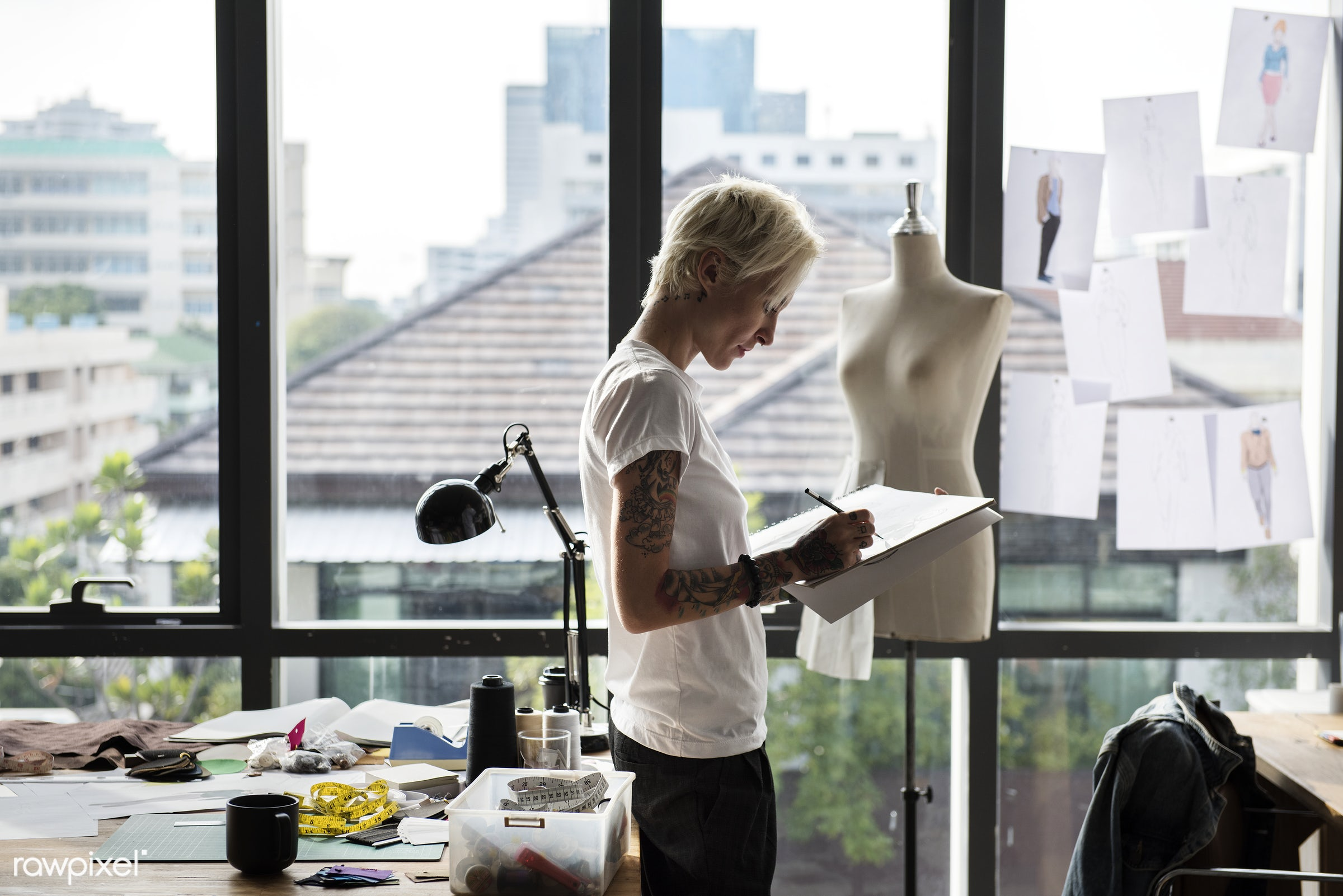 Fashion designer drawing, working in a studio - beauty, cloth, clothes, clothing, collection, concept, costume, creative,...