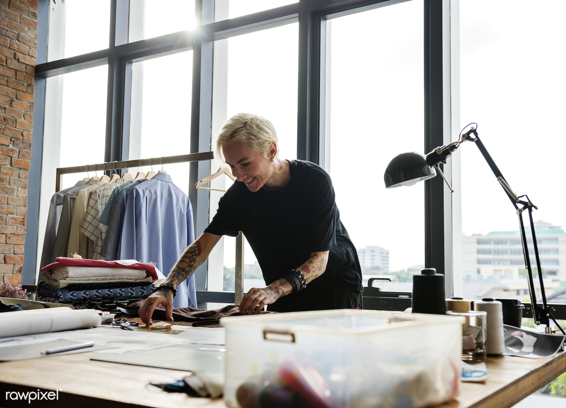 Fashion designer working in a studio - choose, choosing, choosing materials, cloth, clothes, clothing, clothing materials,...