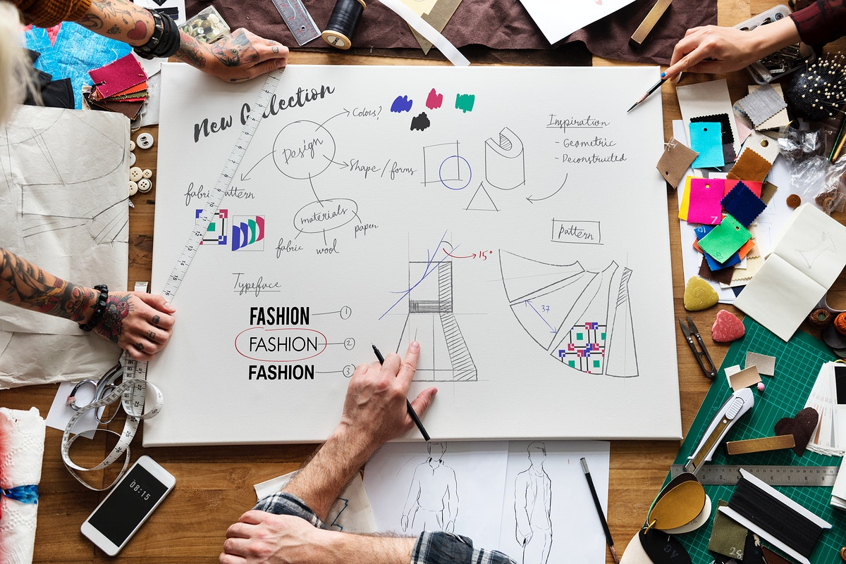 Fashion designers drawing, working in a studio