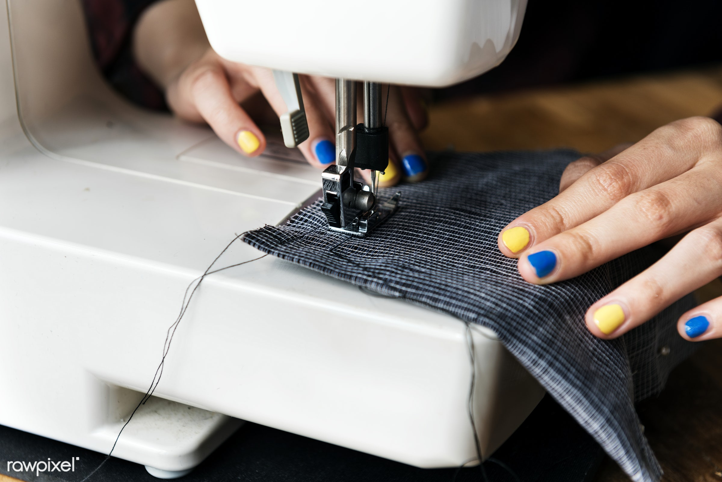 Fashion designer using a sewing machine - trends, sew, fashion, detail, craft, clothing, garment, fashion studio, profession...