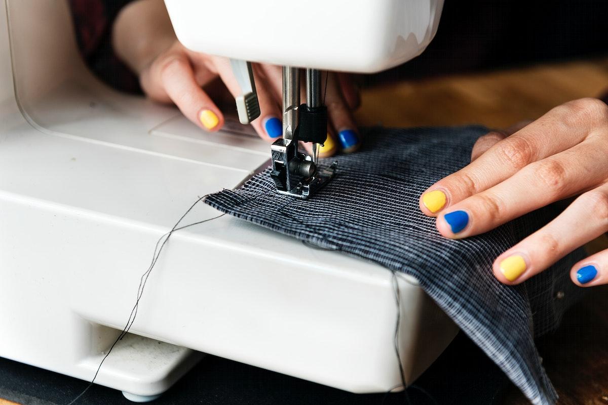Fashion designer using a sewing machine