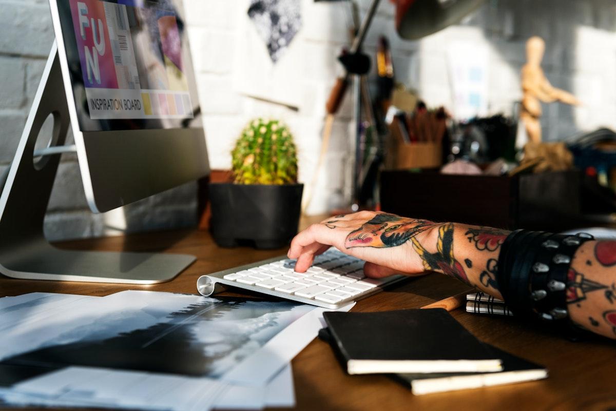Fashion designer working on a computer