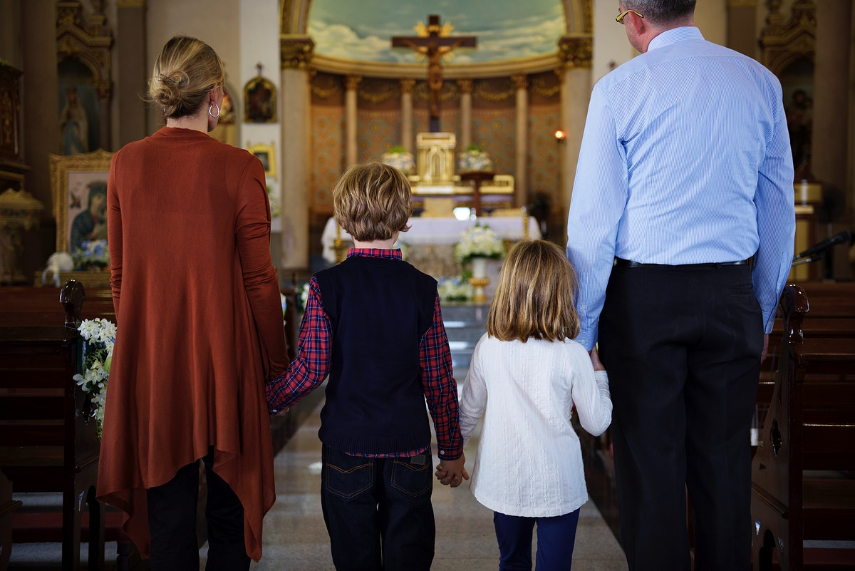 A family praying together inside a church