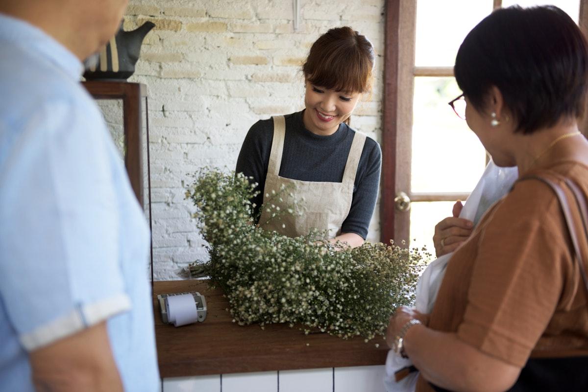 Woman selling flowers in a flower shop