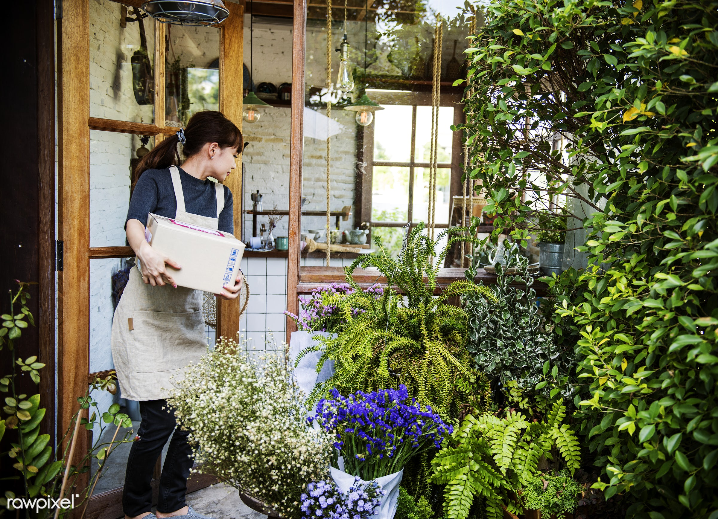 Woman working in a flower shop - florist, asian, store, shop, woman, japan, retail, apron, coffee shop, start up, owner,...