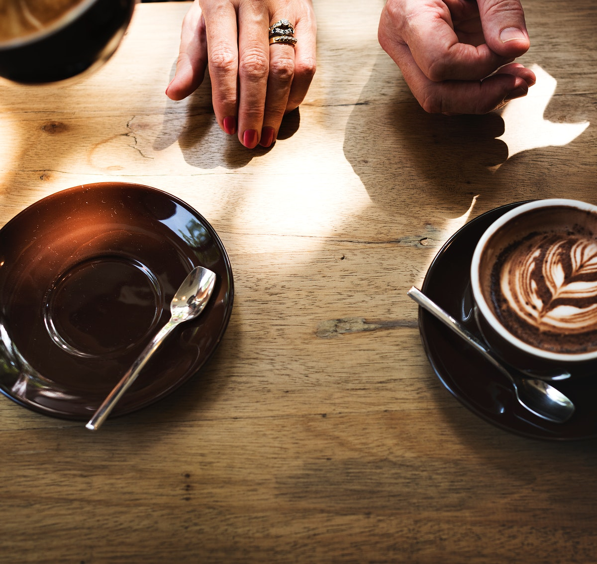 Coffee foam froth art on wooden table