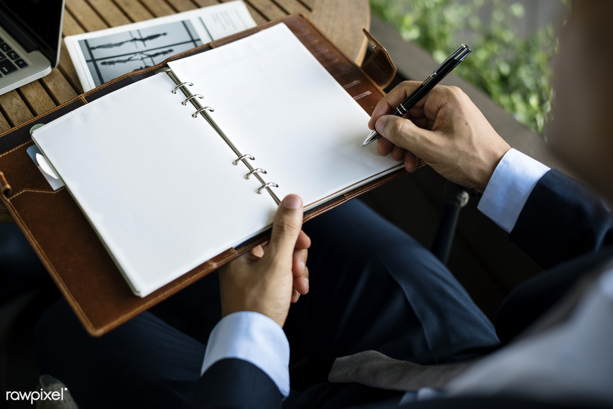 Businessman writing on a personal notebook copyspace - mockup, adult, business, businessmen, businesswomen, collaboration,...