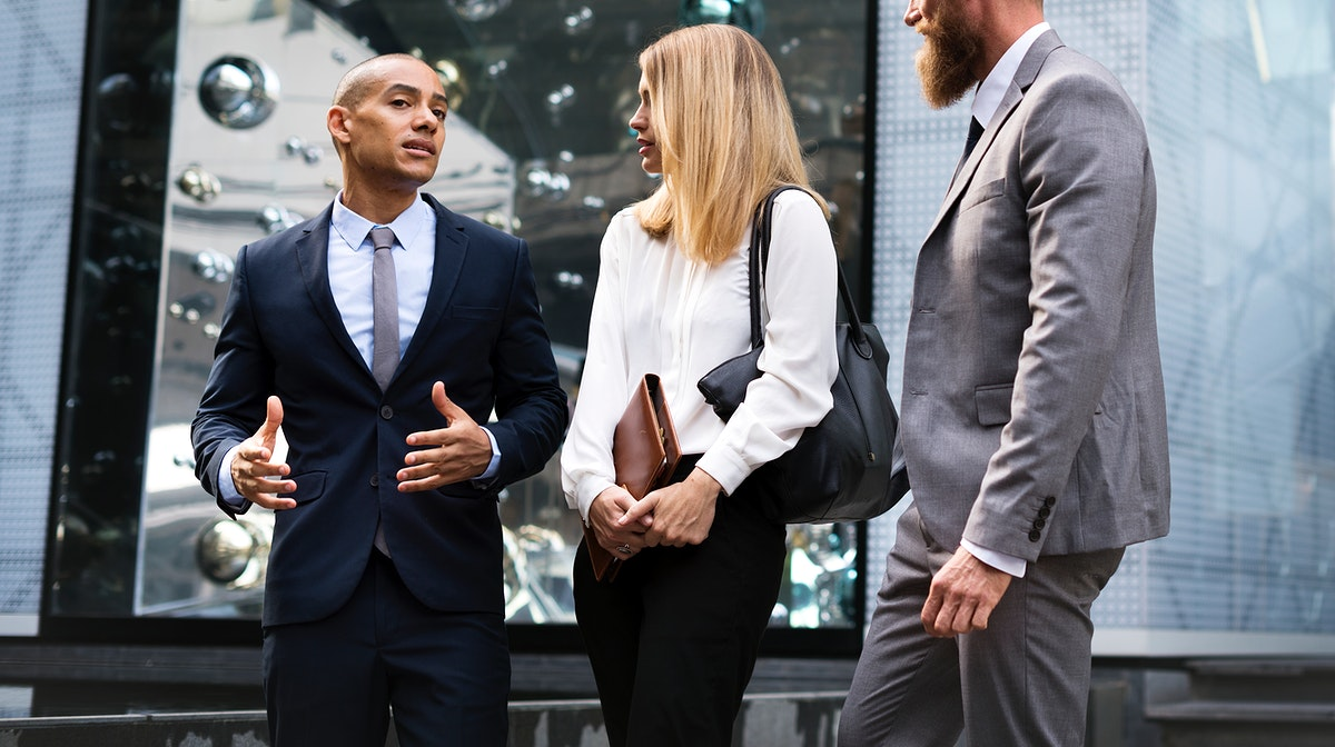 Business people having a discussion outdoors