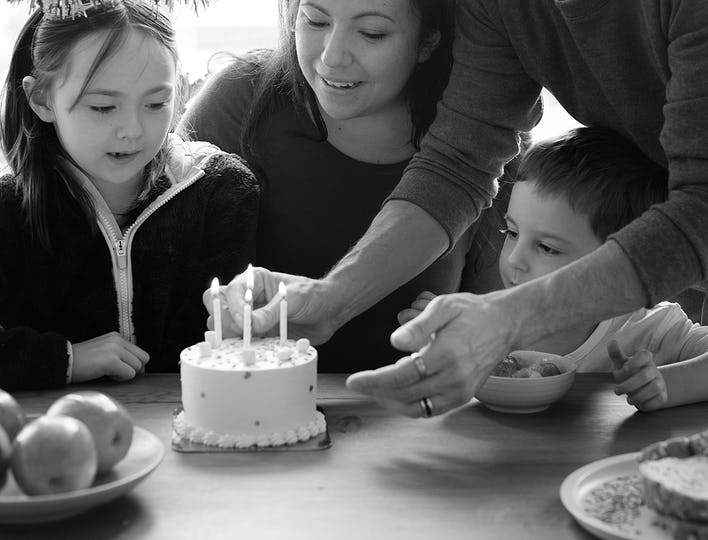 Kid celebrating birthday with his family