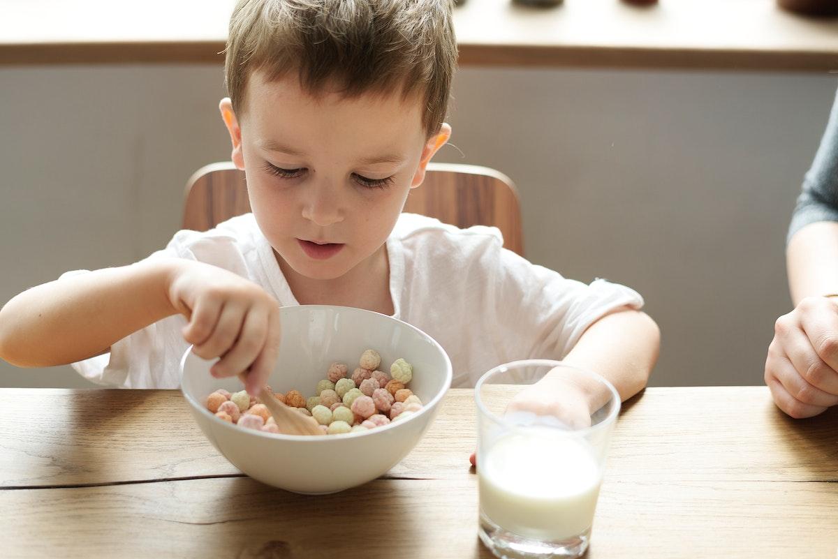 Little boy enjoying a bowl of cereal
