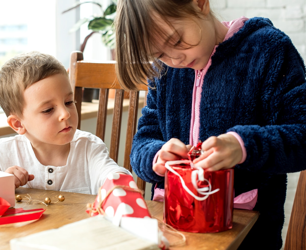 Children wrapping present
