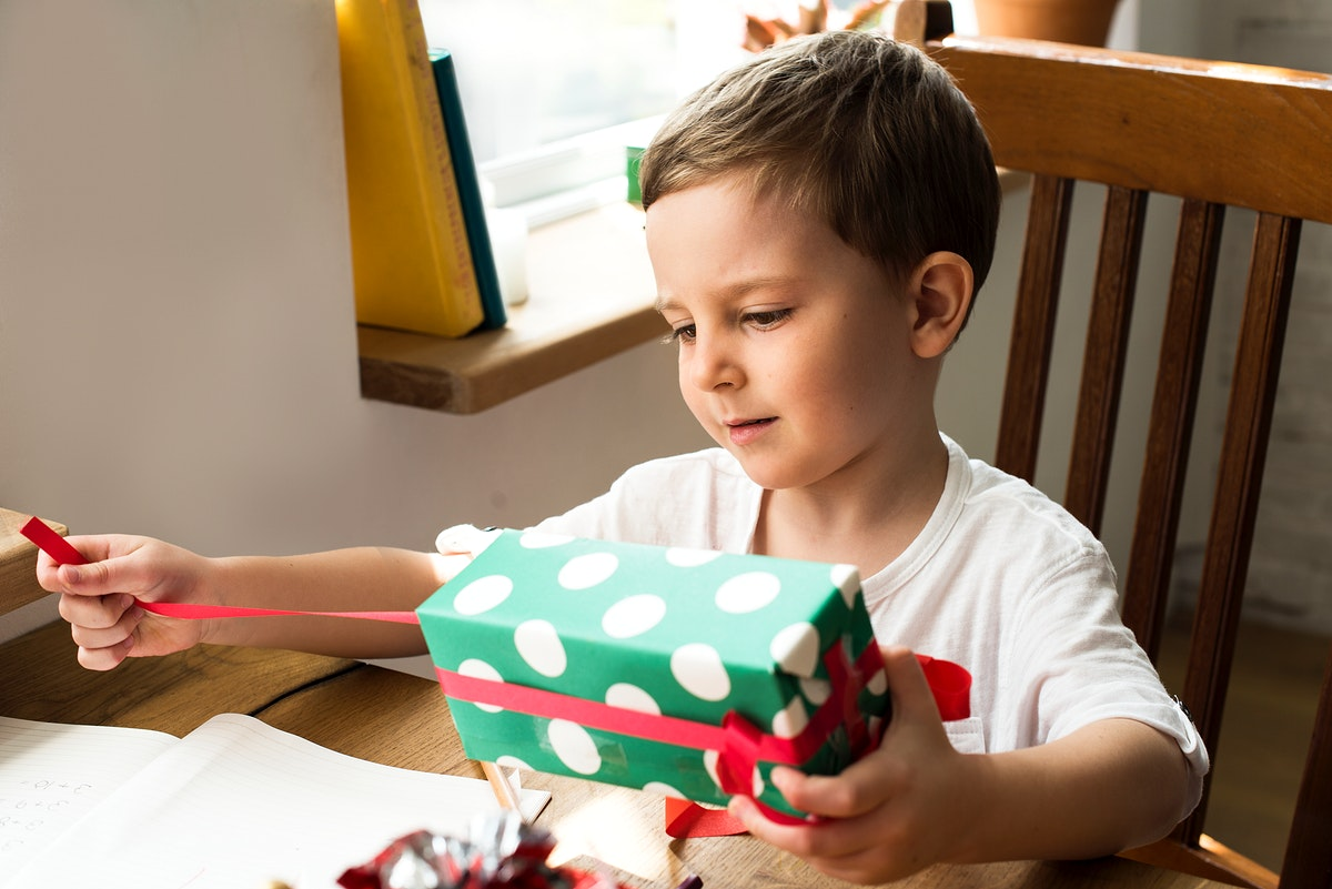 Little boy unwrapping a present