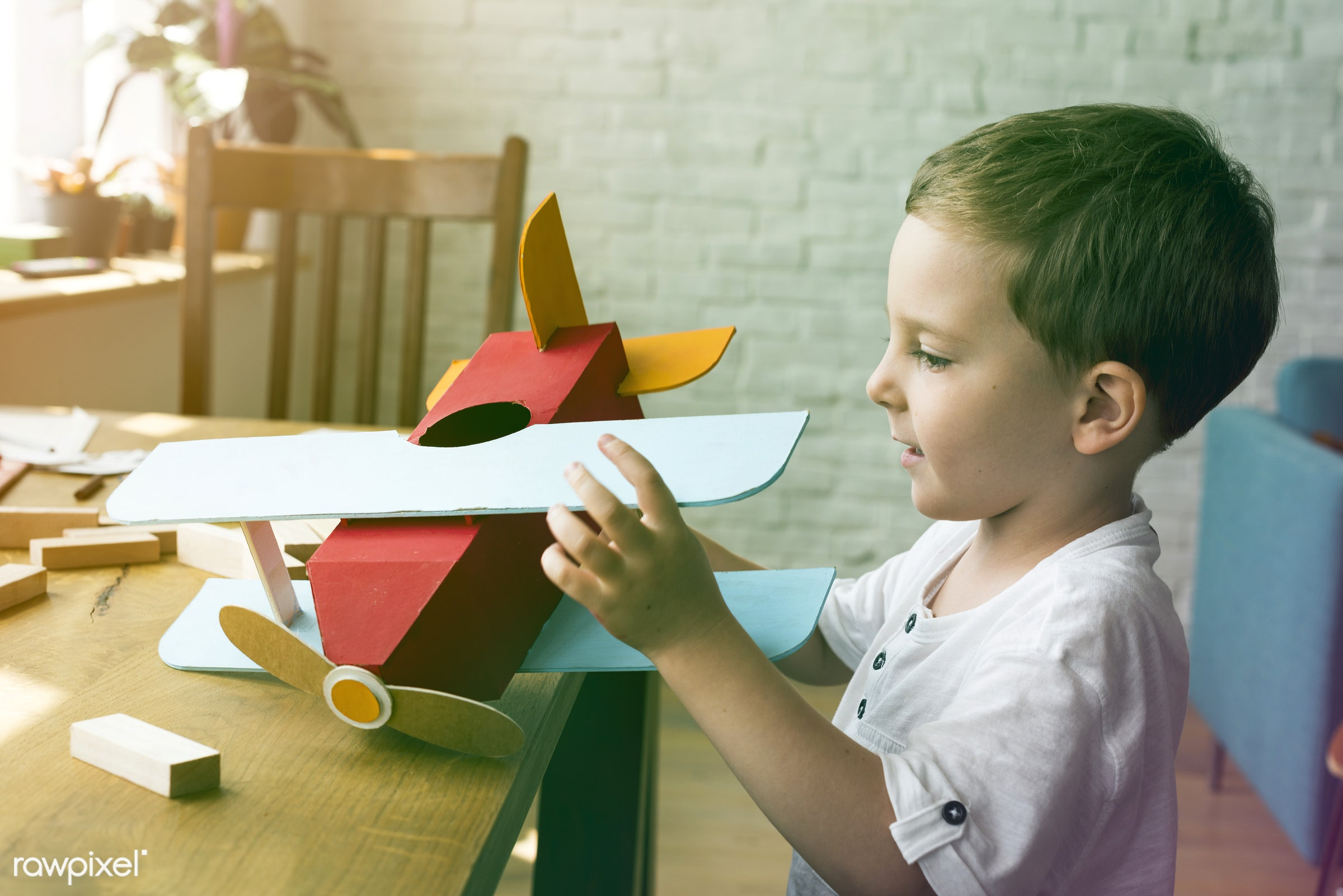 home, person, holding, indoors, travel, object, house, recreation, imagination, kid, caucasian, playing, child, aviation,...