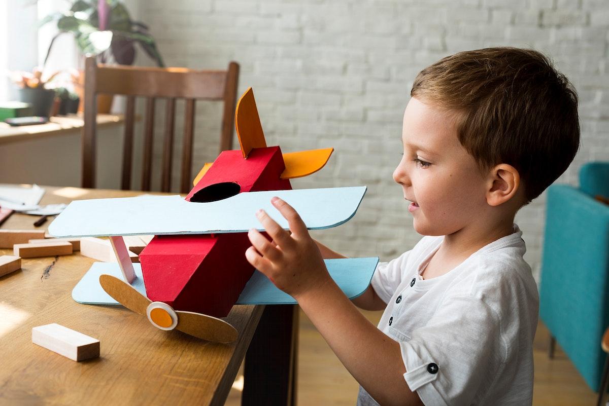Boy Playing Plane Toy Aspiration