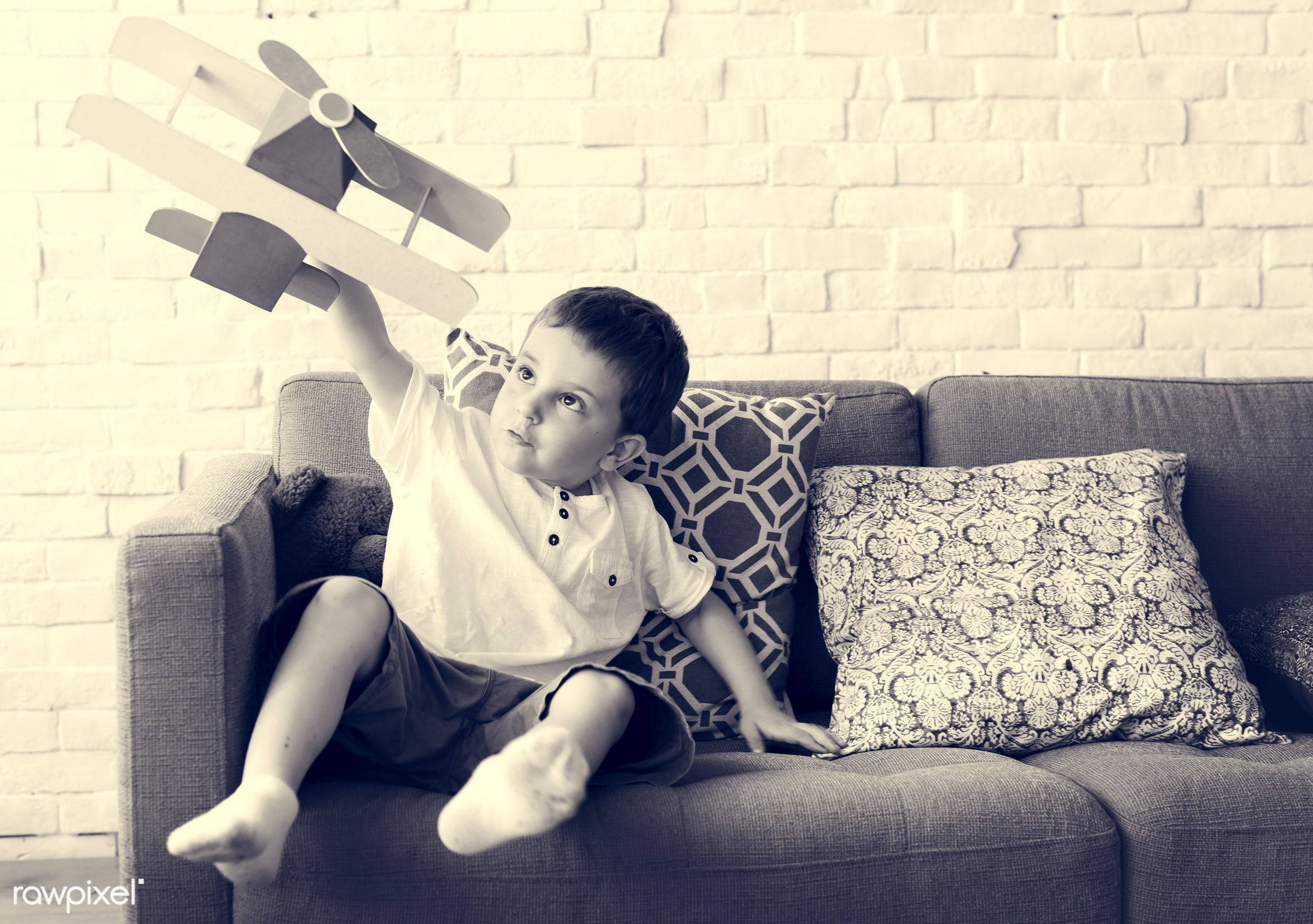 home, person, holding, indoors, house, object, travel, recreation, kid, caucasian, playing, child, aviation, flying, toy,...