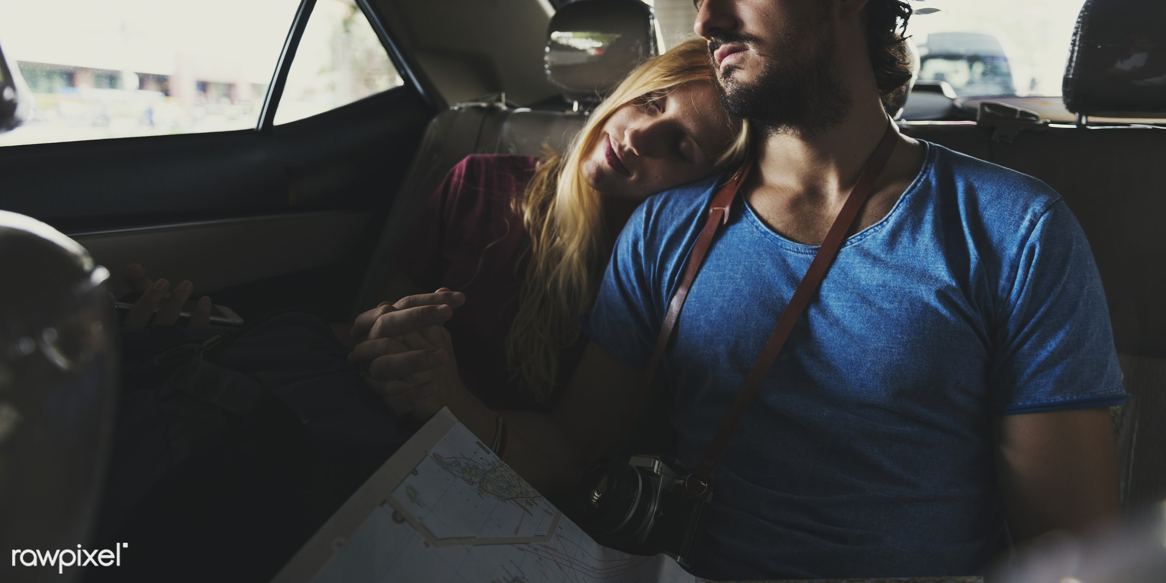 Couple riding a cab on their way to their destination - taxi, trip, adult, automobile, backpackers, blonde, boyfriend, cab,...