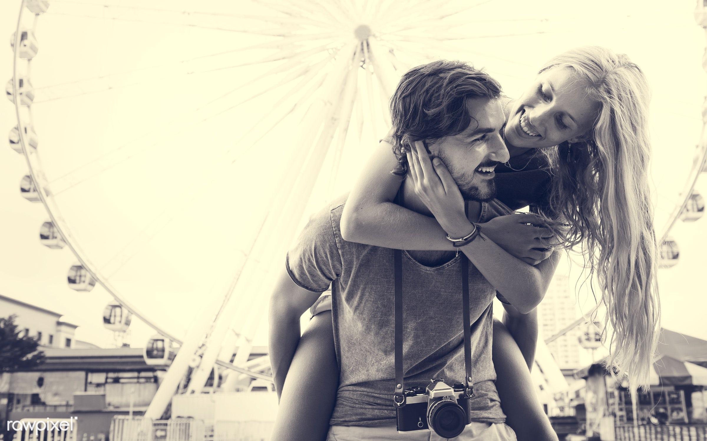 adult, affection, amusement, beard, blonde, bonding, boyfriend, carousel, carrying, casual, caucasian, cheerful, city,...