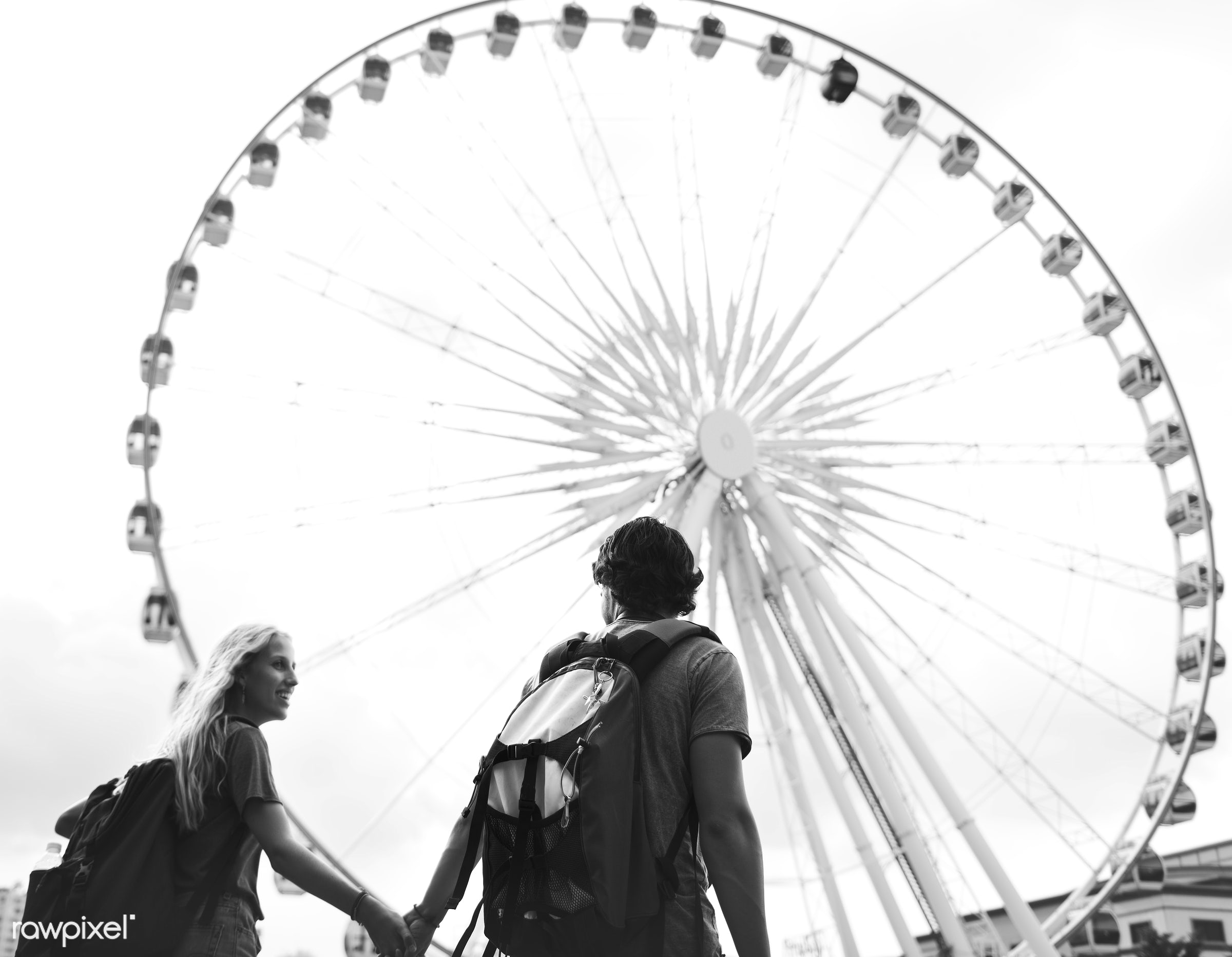 Couple having a sweet time together in an amusement park - adult, affection, blonde, bonding, boyfriend, carousel, casual,...