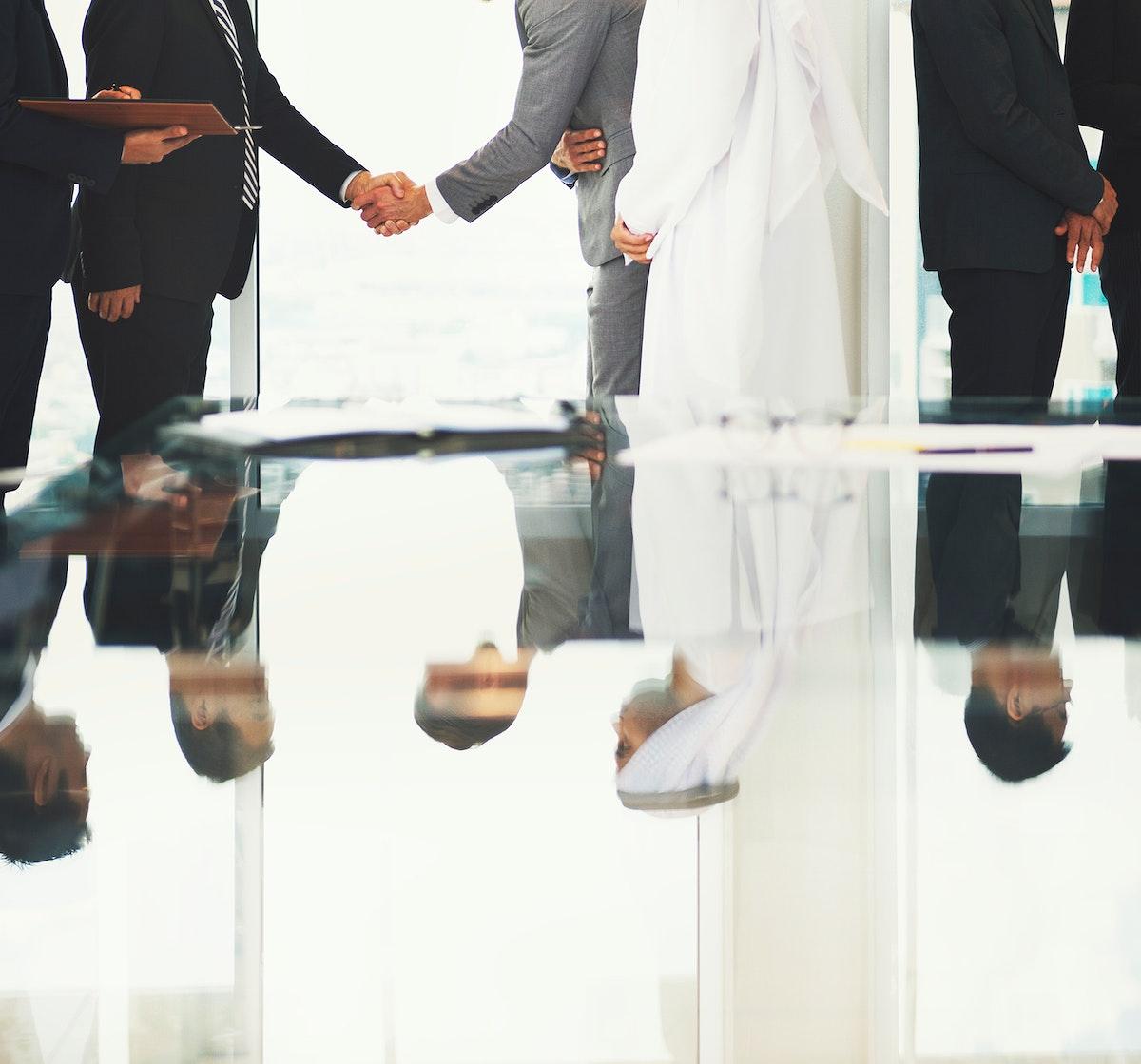 Corporate business people handshaking