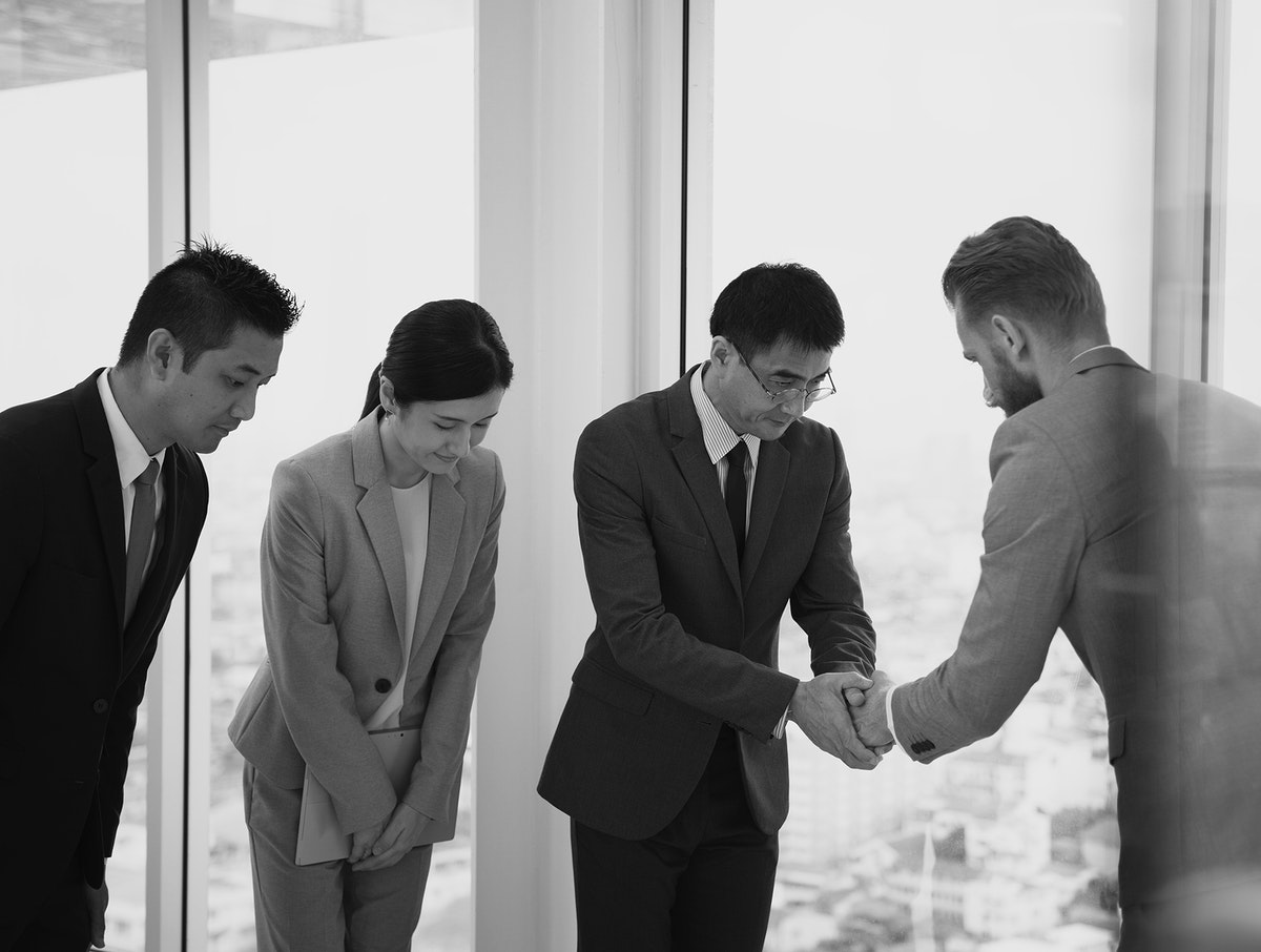 Japanese businessman people having a handshake with a colleague