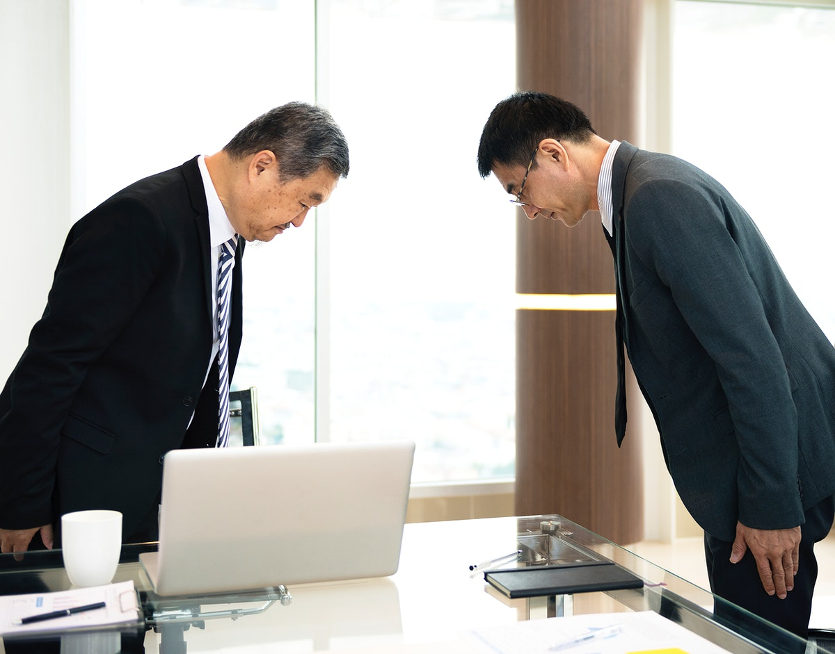 Japanese businessmen shows respect to each other by bowing