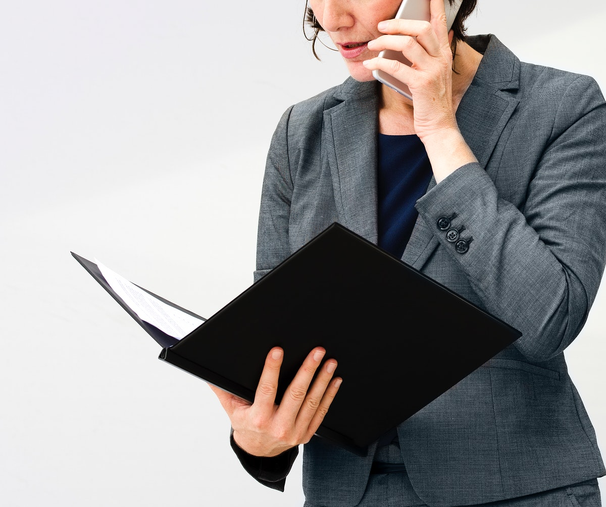 Businesswoman Talking Using Phone Working Busy