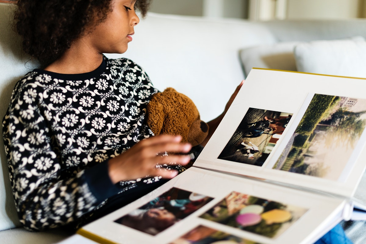 African child looking through a photobook