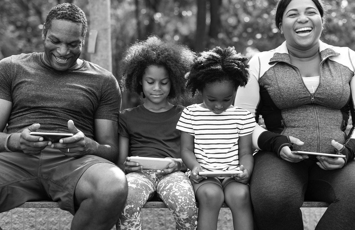African family having a great time together on a park