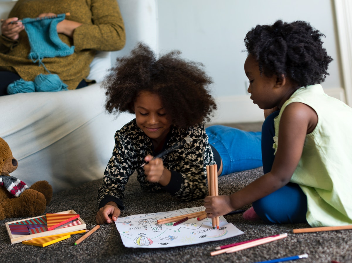African children drawing together