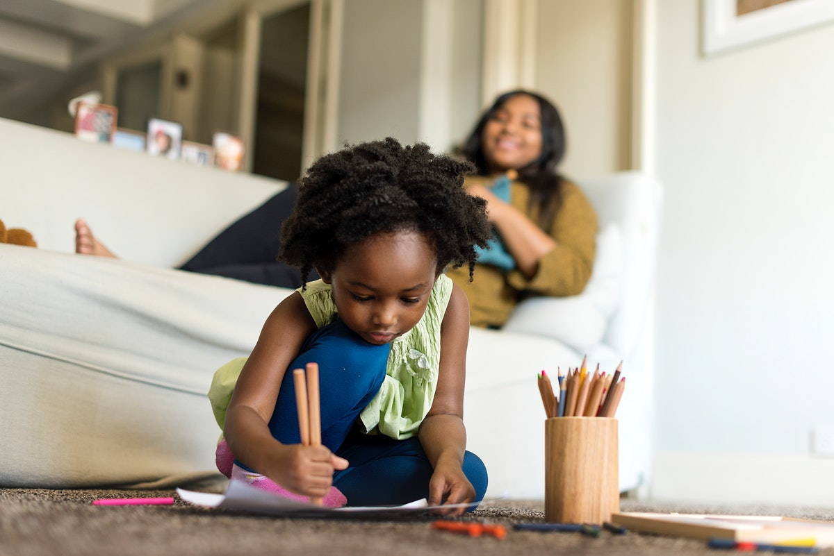 Young african child spending some time drawing