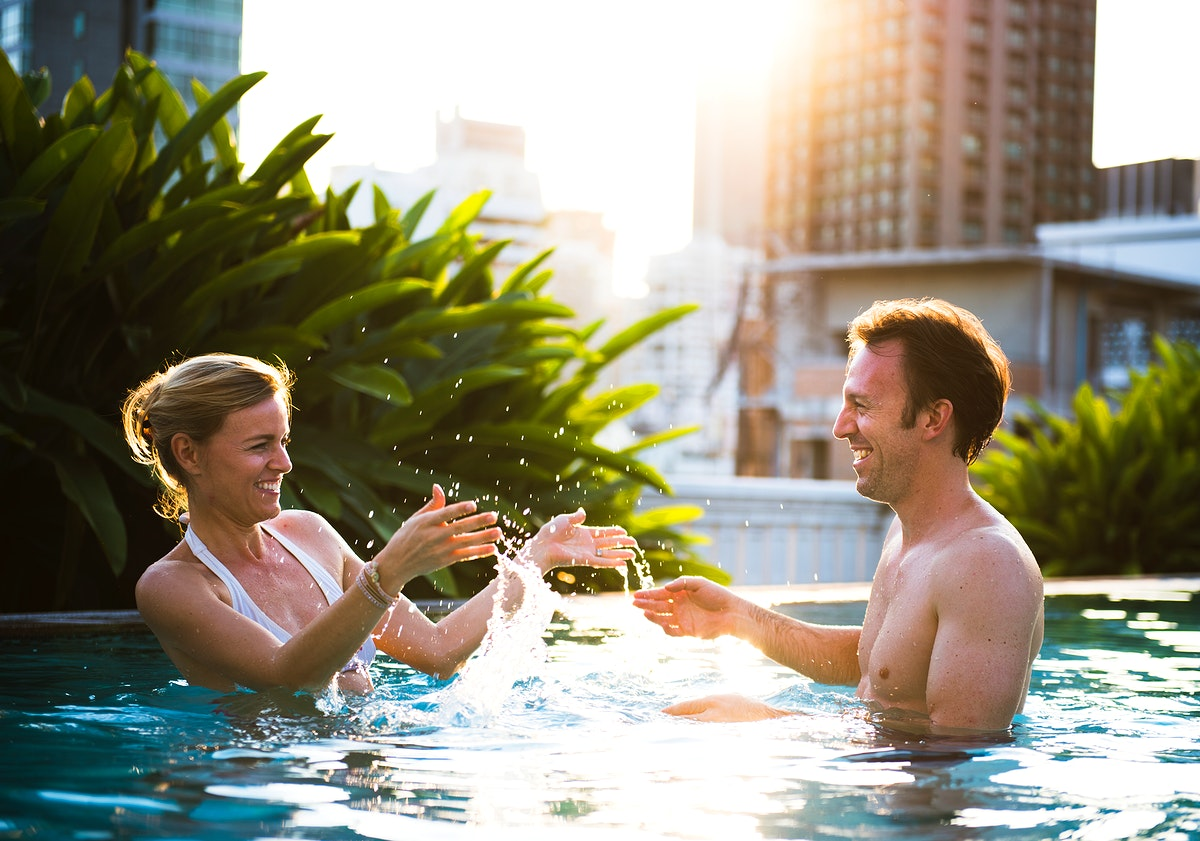 Lovely couple having a great time on a swimming pool