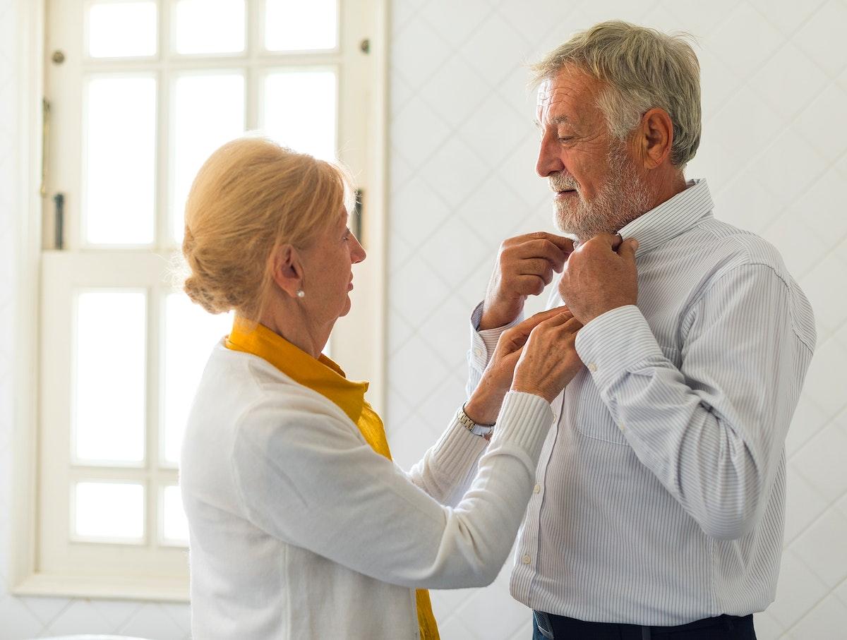 Senior Couple Help Together Dress Up