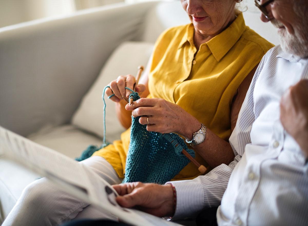Senior Couple Read Newspaper Crochet