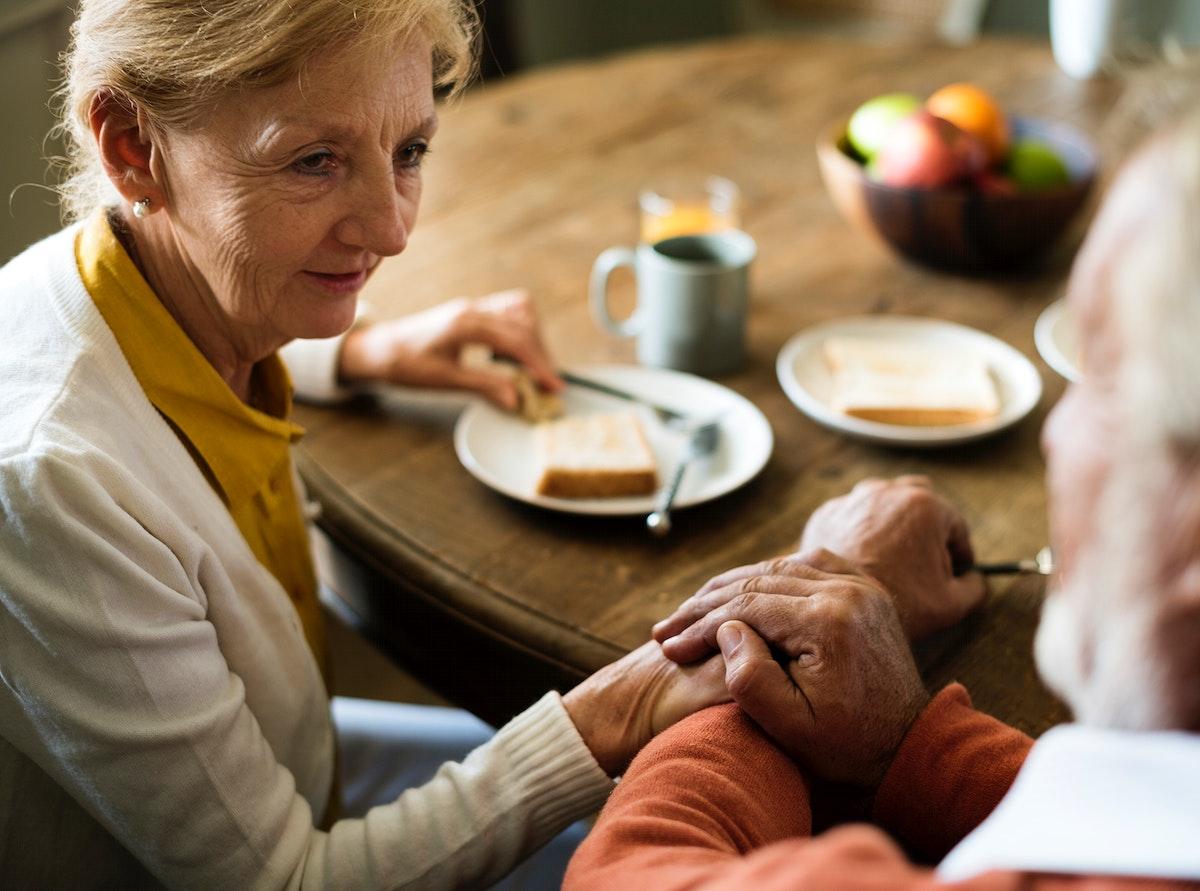 Senior Adult Couple Eat Breakfast