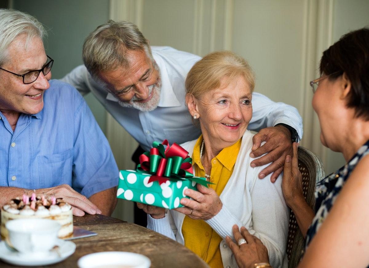 Elderly woman receive a gift