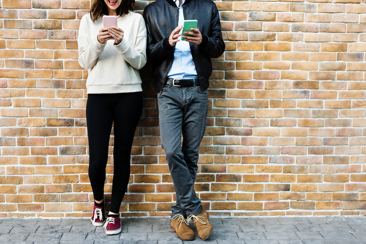 Couple messaging each other by phone
