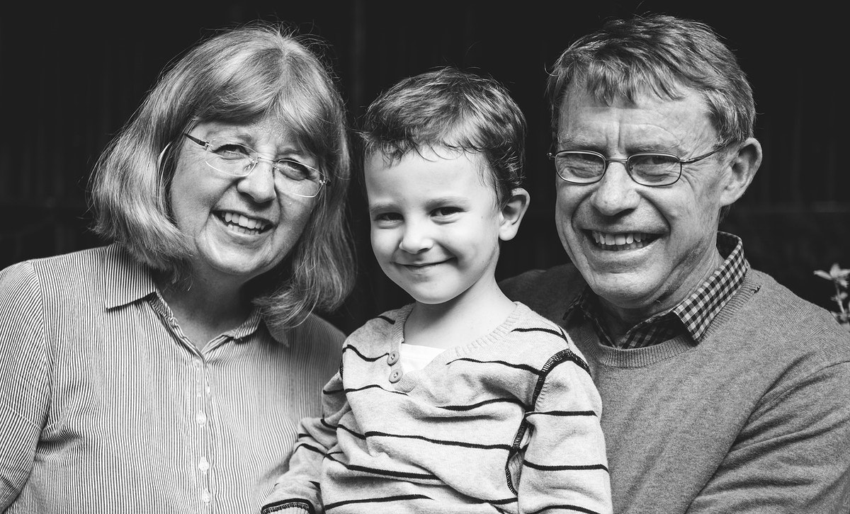 Caucasian kid with grandparents cheerful family portrait