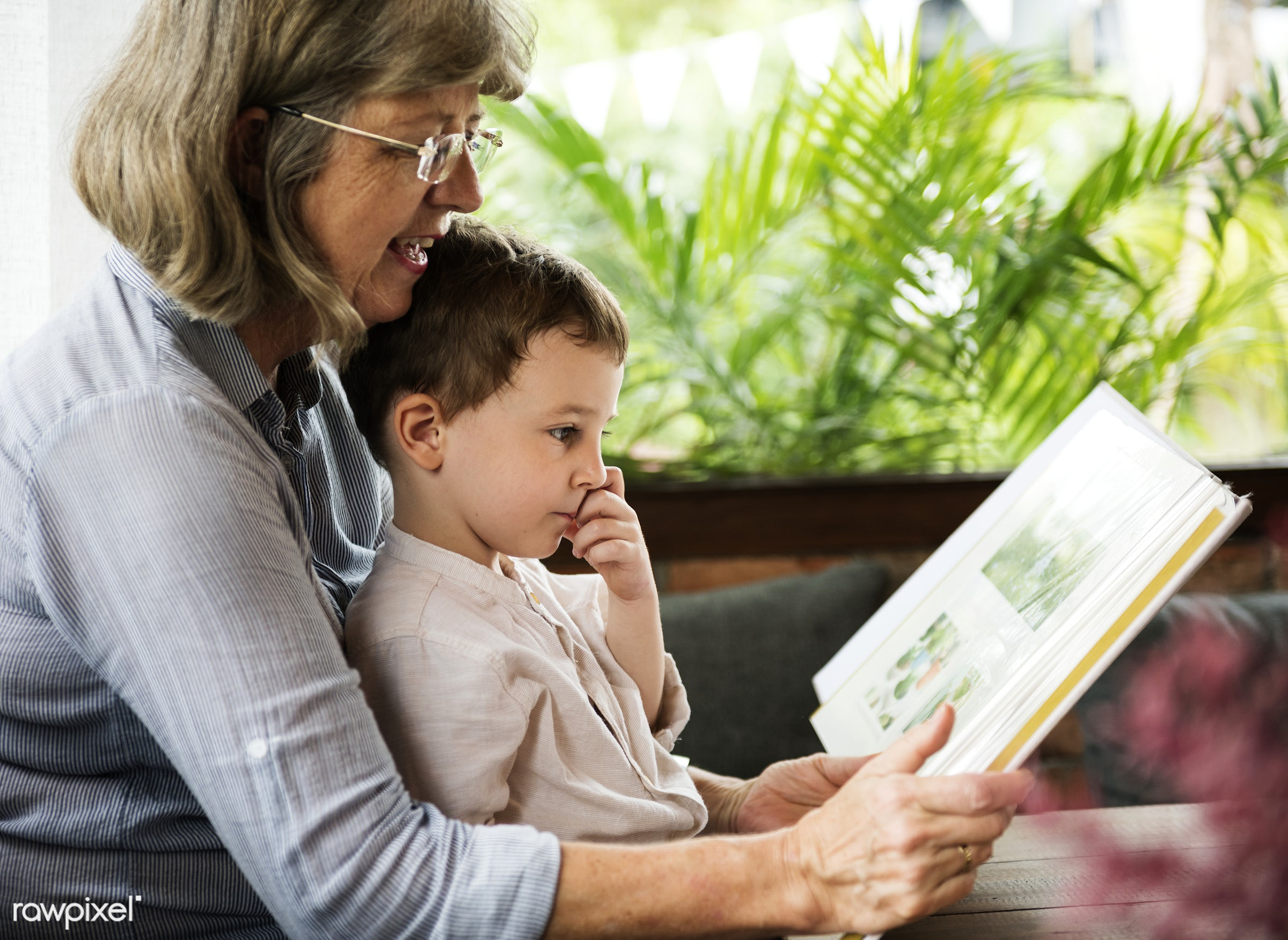 Grandmother and grandson reading a book together - bonding, book, boy, child, family, grandmother, grandson, home, kid,...